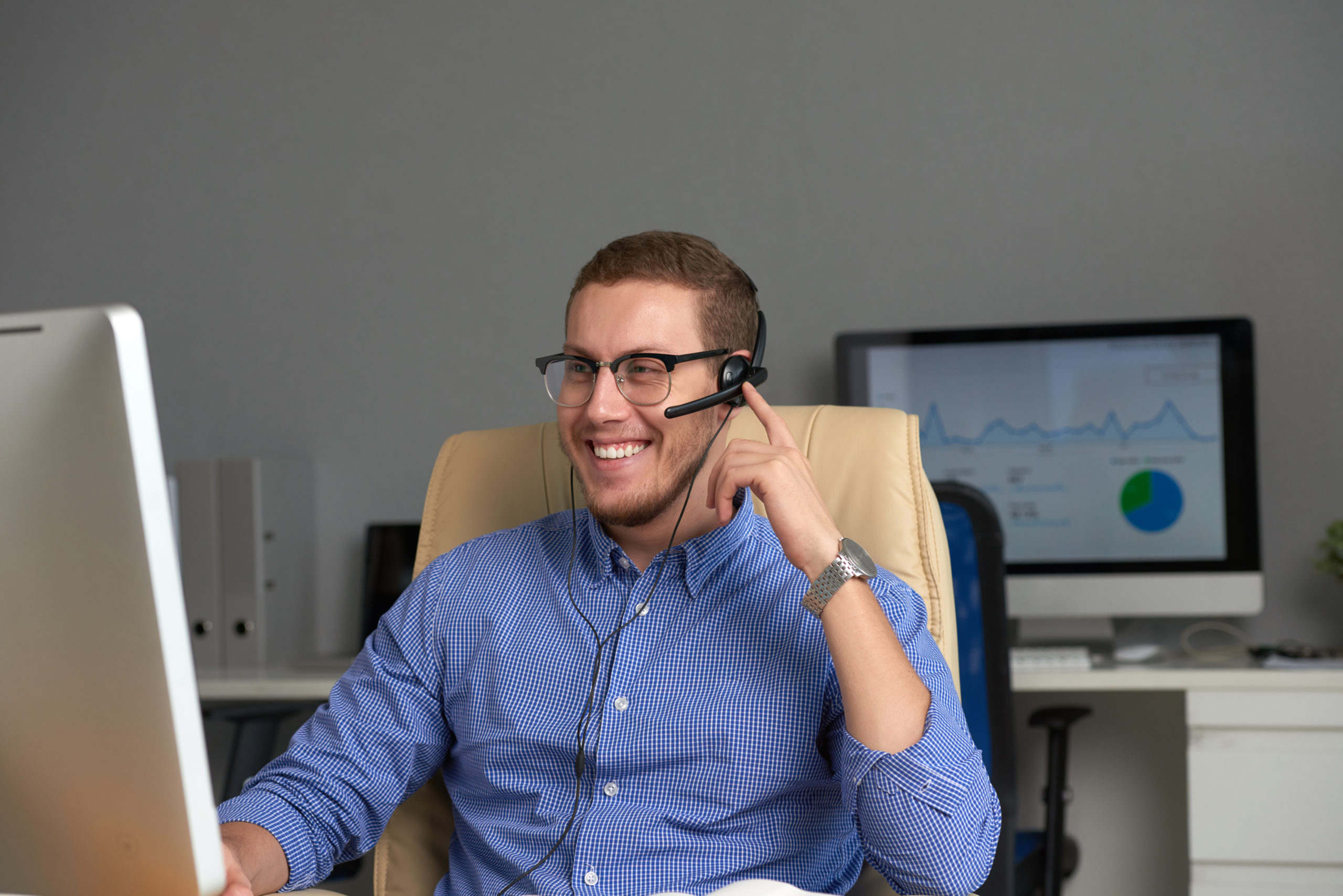Happy businessman working in office